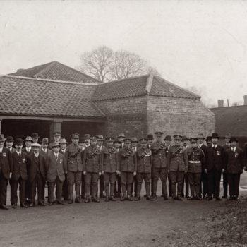 Soldiers & Men on parade in an Escrick Estate yard (WW1 era)