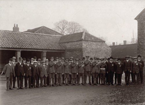 Soldiers & Men on parade in an Escrick Estate yard (WW1 era)