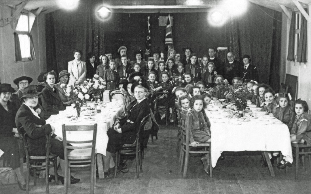 Girl Guides & Brownies in the Bowling Green Hut (Riccall) – Miss Powell – Guide Leader next to Vicar