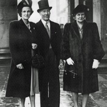 Mr & Mrs Bass outside London House