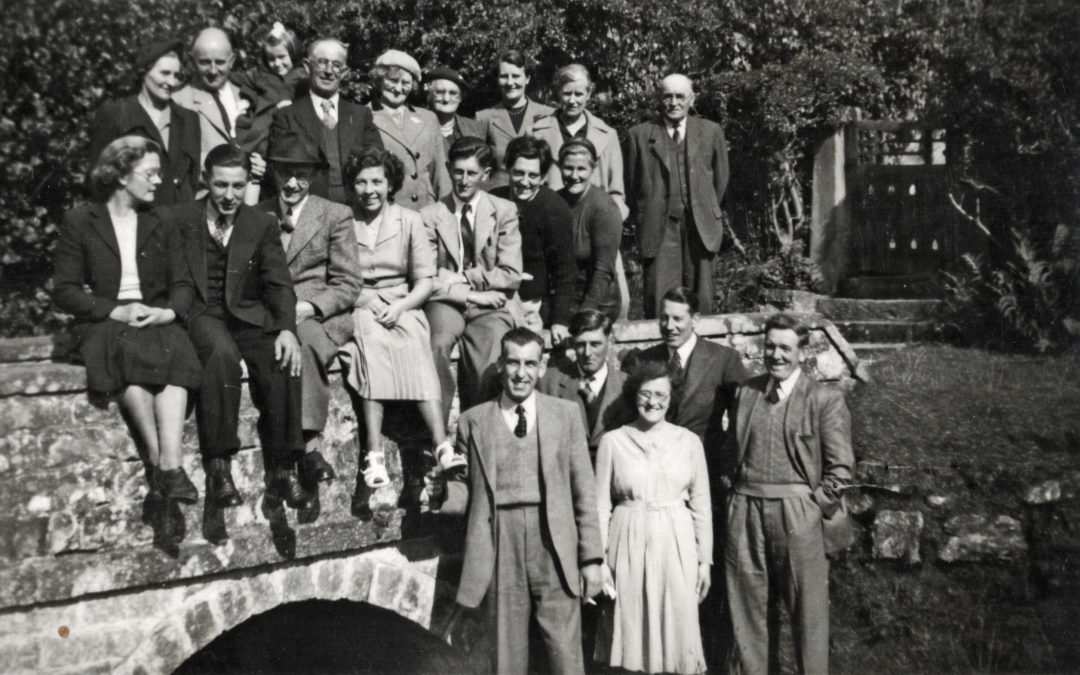 Escrick folk prior to a Day Trip, gathered round the lower bridge over the beck