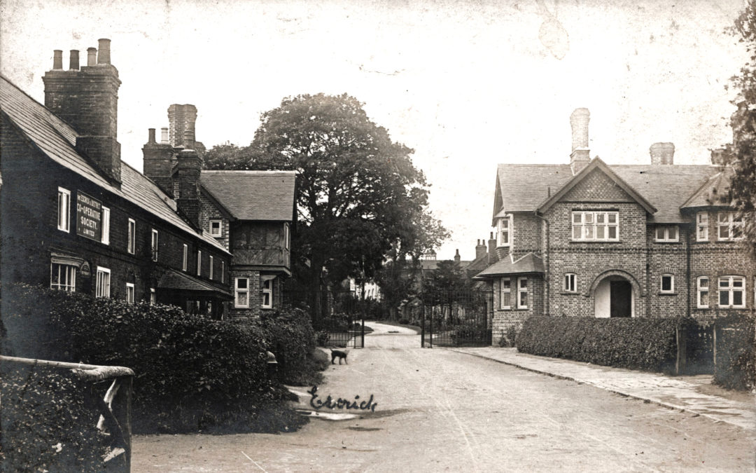Postcard of Escrick Main Street – Co-op & Water Supply Hydrant on left & Park Gates in background
